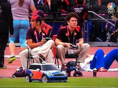 The remote-controlled mini Mini Cooper that shuttles javelins and discuses to athletes.  How fun to be a controller!