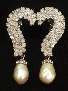 Glamorous pair of old Hollywood rhinestone and pearl statement earrings by Vendome. These measure about 2H x 5/8 W. They are in excellent condition, with no stones missing. The clip backs are adjustable so you can make them tighter or looser for your comfort. Marked Vendome on the back of the clip. These would be perfect for your wedding day, or a black tie event! Thanks for visiting our shop.