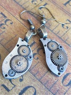 Steampunk ear gear  Element of atomic number 47   by steampunkjunq  #steampunk #earrings