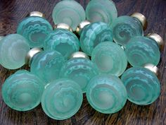 This could be a fun DIY with some Mod Podge and food coloring.  :)  Shades of green by Merlin Glass Door Knobs and Pulls