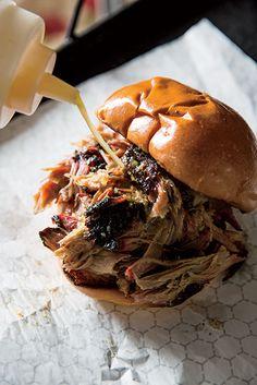 A pork sandwich with spicy vinegar-pepper sauce at Gatlin's BBQ. Photo Credit: Peden + Munk.