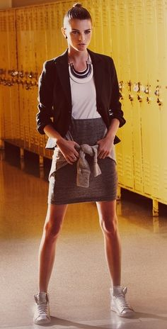 Pencil skirt, blazer, awesome necklace and metallic high tops? Too cool.