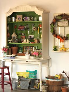 A thrifted hutch gains a second life as a dreamy garden work table. Adding pegboard to the back keeps tools within easy reach, and the detailed trimwork adds much-needed flair to a spare space.