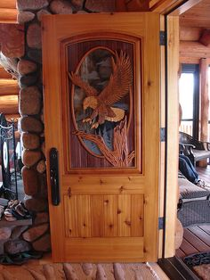 Hand carved eagle over etched/insulated glass oval in cedar door : eagle woodworking doors - Pezcame.Com