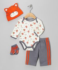 Ready for adventure, this practical set has everything a little one will need to approach the day. Made of soft cotton that's easy to wear and easier to wash, it'll keep tiny wigglers covered and cozy from the tops of their heads to the tips of their toes.Includes bodysuit, pants, beanie and socks100% cottonMachine wash; tumble dryImported
