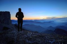 Vercors Tranquility - Female hiker looking at the tranquil and cold sunset in Les Vercors mountains, France.