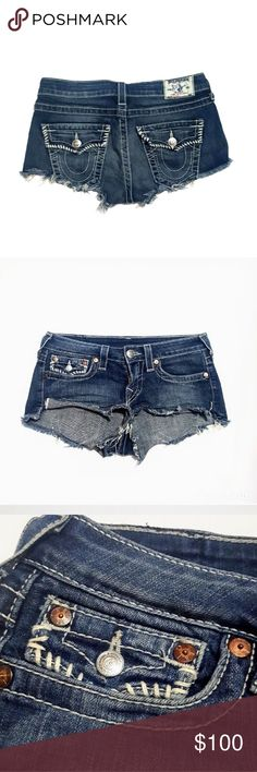 """True Religion Denim Cutoff Shorts Size 27 Excellent condition. Authentic, as shown in pics. Low rise. Some signs of wear, mainly some pilling on the inside/back of pockets and mild fading in addition to the company distressing. 98% cotton, 2% spandex.  Waist approx 14.5"""" across when flat, inseam approx 1.5"""".   Pics taken in different lighting so you can get an idea of the color. True Religion Shorts Jean Shorts"""