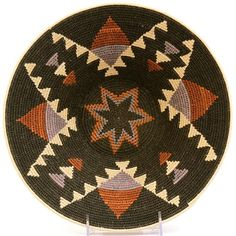 Africa | Masterweave basket from Swaziland | Made from Sisal; each fiber is harvested, dried, hand dyed, dried again, then rolled against the weaver's leg until the perfect thread is drawn out. An average of 80 hours per 12 inch diameter basket makes these one of the most labor intensive of all African baskets for their size.