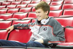 Athens senior photography. Cool senior photo for guys - show their interests - music and attending UGA! in Stegeman Coliseum by Claire Diana Photography