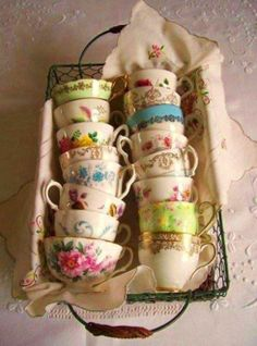 Great way to store and display a collection of tea cups....Or if you have a huge collection, have some in stands, and some in baskets like this.