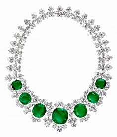 An extremely rare diamond and emerald necklace. The seven very large circular Colombian emeralds total 118.46 carats