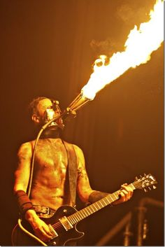 Paul Landers of Rammstein wearing a pyrotechnic mask while playing Feuer Frei thumb 14 Photographs of Fire Breathing acts