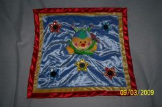 """Baby Gund Blinky Activity Blanket in CelestialBoutique's Garage Sale in Morgan City , LA for $17.95. Made by Baby Gund, this loveable little guy features a bright and colorful blue blanket with yellow and red satin trim.    The Blinky Activity Blanket measures 17"""" x 17'.  The blanket has 5 different activities to keep baby busy including:    1.  giggles    2.  crinkles    3.  a squeaker    4.  rattle    5.  mirrors  Your choice of name can be embroi ..."""