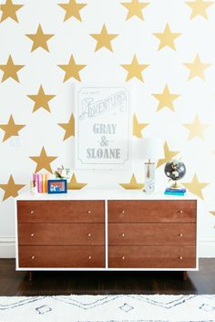 Gold Star Wall Decals from @urbanwalls - love the bold impact this accent wall makes in a kids room! #projectsibling