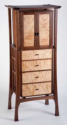 Levichest - Material:  Walnut, Quilted Maple, Ebony.  Artist: Brian K. Carnett.  http://americanwoodworker.com/