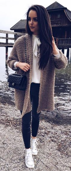 trendy outfit : knit sweater + blouse + bag + black skinnies