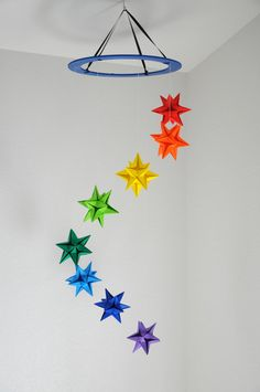 Carefully and lovingly handmade origami star mobile with eight brightly colored paper stars made from high quality origami paper. The stars hang