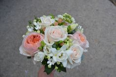 Coral and champagne roses for a wedding bouquet by Peamore Flora.