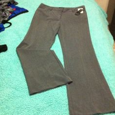 JcPenny Star City gray slacks pants with tags These are brand new with tags! Never worn JcPenny Star City brand pants in size 9 in a beautiful gray color. Perfect for the office or a night out! They are have a slight flare and are flattering for any body type. Zipper, button and clasp closure with 2 front pockets and 2 back pockets and belt loops! Happy poshing I bundle with @smilelove make me an offer I can't refuse Star City Pants