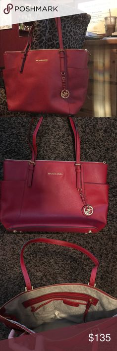 Michael Kors jet set purse This is a Michael Kors red jet set large handbag. It's only been used a couple times and is in great condition! Michael Kors Bags Shoulder Bags