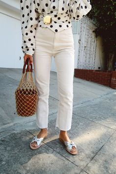 aimee song of song of style wearing a polka dot top, white jeans Street style, street fashion, best street style, OOTD, OOTD Inspo, street style stalking, outfit ideas, what to wear now, Fashion Bloggers, Style, Seasonal Style, Outfit Inspiration, Trends, Looks, Outfits.