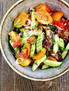 Ingredients (serves 3-4):  1 cup peeled and sliced cucumber 1 cup cut heirloom tomatoes 2 chopped Spring onions or green onions 1/4 cup chopped red onion Dill to taste 1/2 cup of your favorite vinaigrette A sprinkle of hemp seeds for topping to add a little protein (optional)