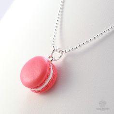 A super cute and sweet-smelling scented rose french macaron necklace. The perfect gift for anyone obsessed with Ladurée french macaron pastries!