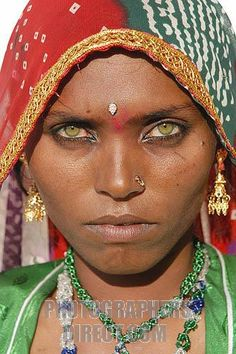 Stock Photography image of Stunning green eyes of a Rajasthani desert ... We are beautiful. Beautiful people of the world.