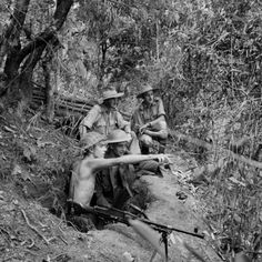 JUL 4 1944 The pitiful Japanese retreat from Imphal From their hillside post, Leading Aircraftmen A Nickson and F Yewbrey of the RAF Regiment point out Japanese positions in the Imphal Valley to their Commanding Officer, Squadron Leader T F Ryalls, and a unit commander, Flying Officer J D Crowhill. At the height of the Siege of Imphal, four RAF Regiment squadrons, and numerous light anti-aircraft flights, were employed in defending the airfields in the valley.