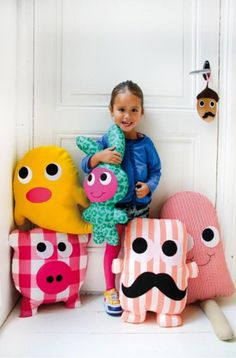 This would be an adorable project. Clean big shapes make them easy to sew! Love the pig