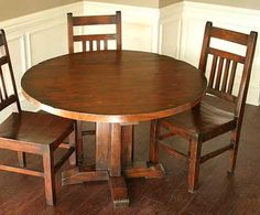 small round wooden table rusty to give off an antique look on the setting of the