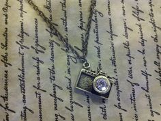 Antique Bronze Camera Charm Necklace With Rhinestone & Chain, Photographer Gift, Photo Prop. $25.00, via Etsy.