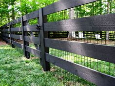 black wood pasture fence with black vinyl coated 2x4 welded wire