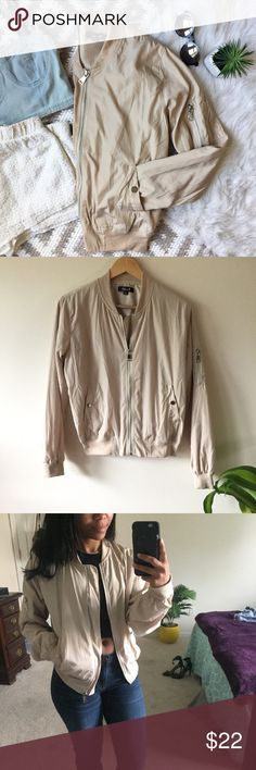 Cream Neutral Bomber Jacket 365 Cream Bomber Jacket   Size M. Runs smaller, fits like a true bomber jacket. Cream tone with silver hardware/zippers. Lightweight.  Lightly lined. In like new condition. No flaws! Length: 23 inches Bust: 21.5 inches Sleeve length: 25 inches Jackets & Coats