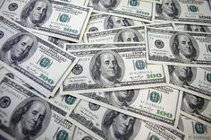 The dollar bumped down from its overnight highs in early Asian trade on Friday, on track for weekly losses in a week marked by continuing uncertainty about U.S. monetary policy, while the euro firmed after the European Central Bank stood pat.
