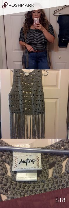 Cute Croche Vest Croche best by Daytrip. So cute and versatile. I wore it once as seen in pic. True to size. It is not long as seen in pic. On trend. It's like a tannish gray color. Price is negotiable within reason. Daytrip Jackets & Coats Vests