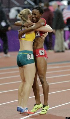 Australia's Sally Pearson, left, is embraced by bronze medallist Kellie Wells of the United States after she won gold in the women's 100-meter hurdles final during the athletics in the Olympic Stadium at the 2012 Summer Olympics, London, Tuesday, Aug. 7, 2012.