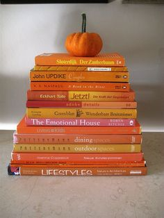 stacks of same colored books - applicable for any season, what a simple and charming idea for a book loving home! ((Or for color of the month learning!))