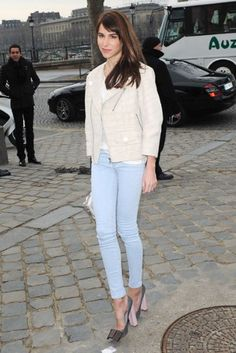Stylist and It girl Caroline Sieber paired her light blue skinny jeans with a white crocodile biker jacket at Paris Fashion Week
