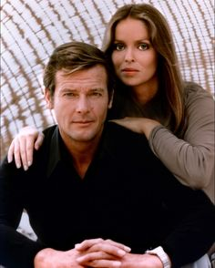 Roger Moore as James Bond and Barbara Bach.