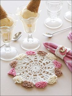 "Layers of ruffles form the confectionery edging on this stitched tabletop pair, a summertime treat for dining guests. This e-pattern was originally published in the June 2010 issue of Crochet World magazine. Size: Doily: 7 3/4"" diameter. Napkin Ring: 2 x 2 3/4"". Made with size 10 crochet cotton thread and size 2 (2.20mm) steel hook. Skill Level: Intermediate"