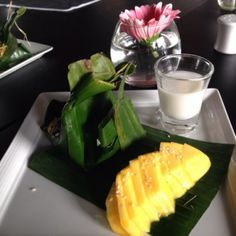 delicious dessert of sticky rice, coconut milk (to pour over it ), and mango.