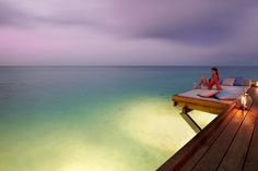 Landaa Giraavaru's Seabar gives guests an extended view of lemon sharks and reef fish in the waters below.