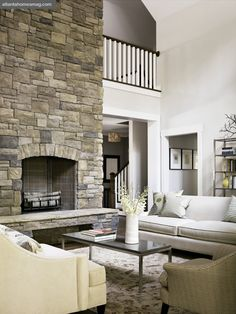 A stone-clad fireplace anchors the living room, where traditional and contemporary style is perfectly balanced.