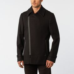 This wool blended peacoat features an asymmetrical zip closure and two side pockets. We suggest wearing it unzipped for a fashionable, voluminous collar effect.