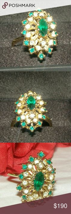 18K HGE Emerald Ring High fashion ring classic Beauty exquisitely. A beautiful emerald in Middle surrounded by round cut crystals and emerald stones. Makes a statement excellent condition. Worn a few times. Jewelry Rings