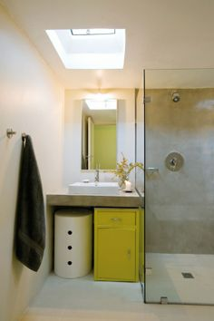 Love the minimal tile usage in this bathroom. Plus the window above for optimal privacy in a crowded city street.