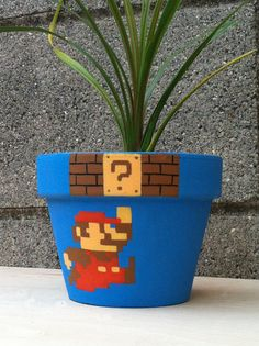 Super Mario Bros Flower Pot - I wish I was more artistic! It's not a fire flower, but it looks cool! Super Mario Bros Flower Pot - I wish I was more artistic! It's not a fire flower, but it looks cool! Flower Pot Crafts, Clay Pot Crafts, Super Mario Nintendo, Super Mario Bros, Painted Flower Pots, Painted Pots, Fire Flower, Deco Retro, Mario Party
