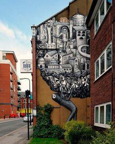 Рисунки на зданиях (23 фото)