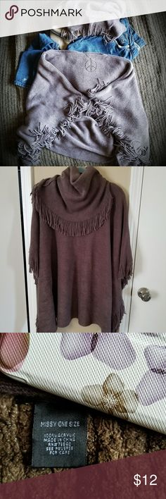 Poncho with Fringe and the feel of Cashmere Poncho with Fringe and the feel of Cashmere.  Color is more like the second photo-dark taupe the cover pic makes it look more gray-it's closer to brown. One size fits most.  Pre-owned in very good condition. See photo for fabric content.  Also includes a matching infinity scarf. Sweaters Shrugs & Ponchos